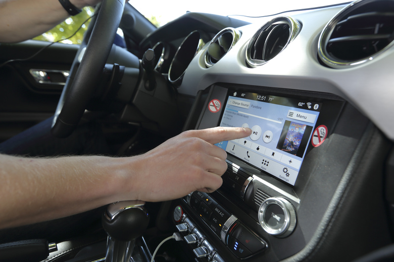 Distracted by tech while driving? The answer may be more tech.