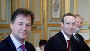 Macron greets Zuckerberg with threat to regulate Facebook